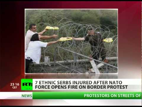 NATO swaps bread for bullets at Serbia-Kosovo border