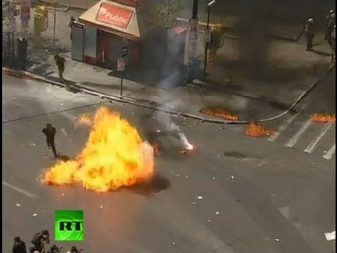 Greece Molotov Rampage: Video of protesters fire petrol bombs at police